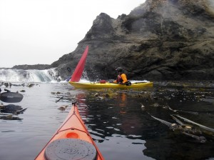 Red kayak with stern deep in the water.
