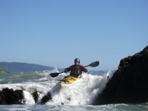 Sea Kayaker paddling a pour-over.