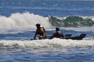 Kayaker and instructor in the surf.