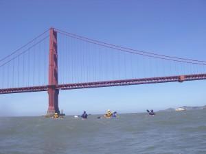 Sea kayakers approaching the Golden Gate Bridge