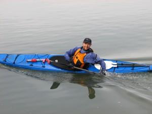 Roger Schumann in blue sea kayak.