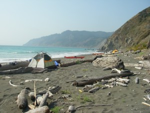 Kayakers camped on the beach.