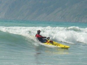 Roger Schumann surfing in his sea kayak